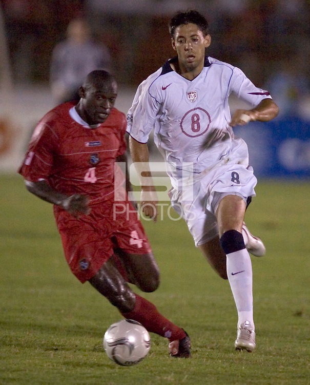 USA's Clint Dempsey dribbles past a Panamanian defenderin the second half in Panama City, Panama, Wednesday, June 8, 2005. The USA won 3-0.