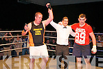 Rumble in Listowel : Referee Sean O'Leary raises the hand of John McGrath v Neilus Flaherty in their heavyweight encounter in the white collar boxing charity event organized by the Kerry Crusaders in The Listowel Community Centre on Friday night last.