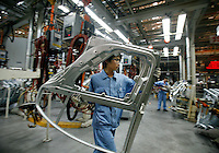 Workers assemble automobiles at the Shanghai Volkswagen (SVW) plant in Shanghai, China..