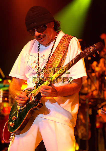 CARLOS SANTANA.Live at The Greek Theatre in Los Angeles, California  October 1, 2004.half length, stage, concert, gig, guitar, hat, sunglasses, shades.www.capitalpictures.com.sales@capitalpictures.com.Copyright Debbie VanStory