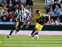 Pictured: Pablo Hernandez of Swansea (R) against Shola Ameobi (L) of Newcastle. Saturday 19 April 2014<br />