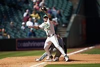 Baylor Bears third baseman Esteban Cardoza-Oquendo (52) reaches for a high throw as Seth Halvorsen (8) slides safely into third base in game one of the 2020 Shriners Hospitals for Children College Classic at Minute Maid Park on February 28, 2020 in Houston, Texas. The Bears defeated the Tigers 4-2. (Brian Westerholt/Four Seam Images)