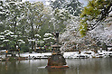 February 29, 2012, Kotesashi, Japan - A bronze crane statue shoots water against driving snow at Tokyos Hibiya Park on Wednesday, February 29, 2012. A freak early spring storm triggered by low pressure in the Pacific Ocean south of Japan brought fresh snow over wide swaths in the Kanto Area from the wee hour of Wednesday, disrupting land-sea-air transportation services. (Photo by Natsuki Sakai/AFLO) AYF -mis-