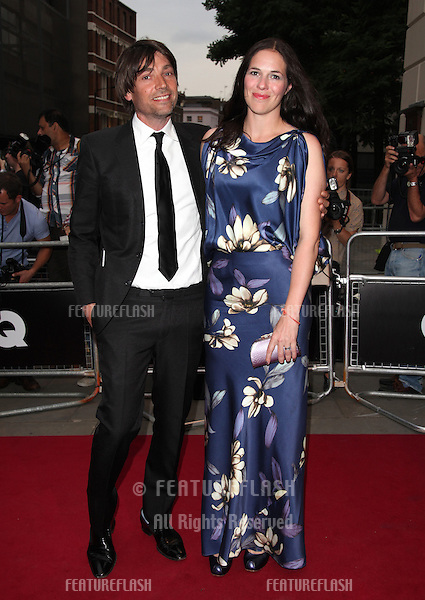 Alex James and wife arriving for the 2012 GQ Men Of The Year Awards, Royal Opera House, London. 05/09/2012 Picture by: Alexandra Glen / Featureflash