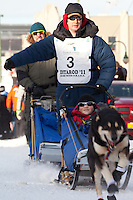 Musher Ray Redington Jr. and Iditarider Branden Bond.leave the 2011 Iditarod ceremonial start line in downtown Anchorage, Alaska