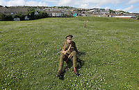 Men in World War I gear in the gardens where the Vetch Field used to be, Swansea, south Wales UK. Friday 01 July 2016