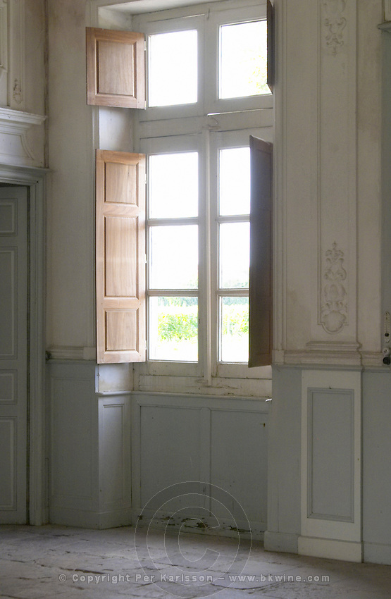 In the stately entrance hall: One of the windows looking out to the garden with soft sunshine shining in Chateau de Cerons (Cérons) Sauternes Gironde Aquitaine France