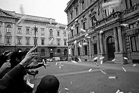 milano, come protesta contro la riforma dell'istruzione,  studenti universitari lanciano verso palazzo marino, sede del comune,  bottiglie di plastica contenenti loro pensieri sulla riforma --- milan, as a form of protest against the school reform, students throw against palazzo marino, headquarter of the municipality, plastic bottles containing their thoughts about the reform