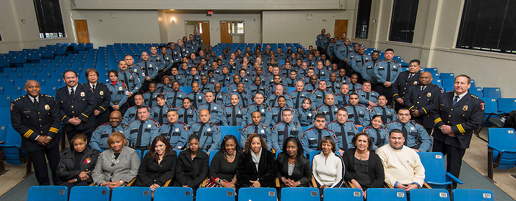 Members of the Houston ISD Police Department pose for a photograph before the swearing-in ceremony for Chief of Police Robert Mock, January 6, 2014, at the High School for Law Enforcement and Criminal Justice.