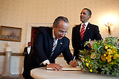 United States President Barack Obama watches as President Felipe Calderón of Mexico signs the official guest book in the Blue Room of the White House, Wednesday, May 19, 2010. .Mandatory Credit: Pete Souza - White House via CNP
