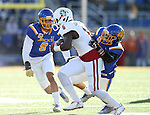 BROOKINGS, SD - NOVEMBER 12:  Jordan Brown #9 and Jesse Bobbit #7 from South Dakota State University team up on a tackle on Tacari Carpenter #6 from the University of South Dakota in the first half at the Dana J. Dykhouse Stadium November 12, 2016 in Brookings, South Dakota. (Photo by Dave Eggen/Inertia)