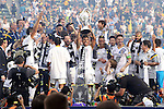 07 December 2014: Los Angeles's A.J. DeLeGarza (20) holds the Philip F. Anschutz Trophy overhead. The Los Angeles Galaxy played the New England Revolution in Carson, California in MLS Cup 2014. Los Angeles won 2-1 in overtime.