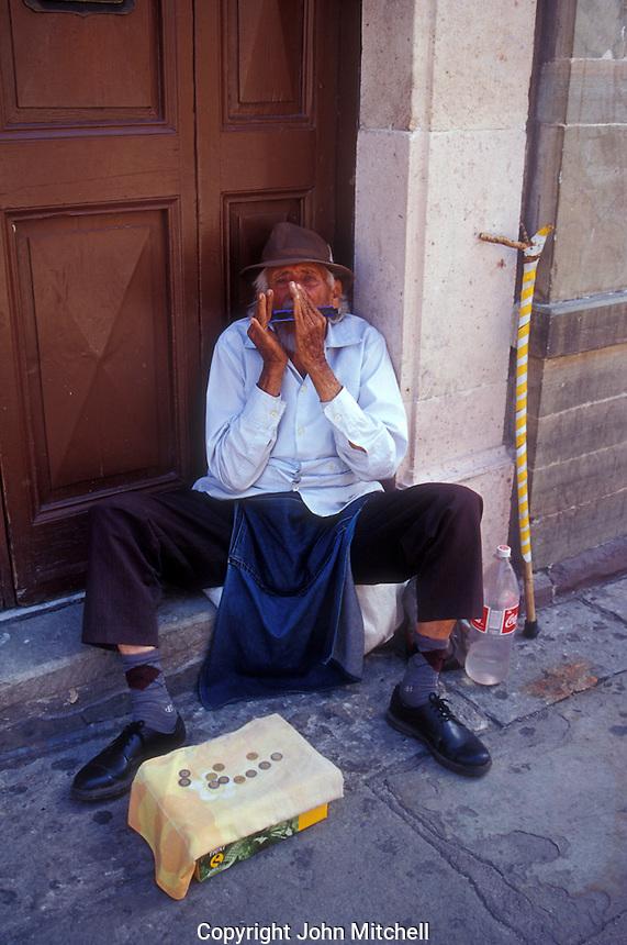 Elderly harmonica player in the city of Guanajuato, Mexico