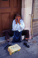 Elderly harmonica player in the city of Guanajuato, Mexico