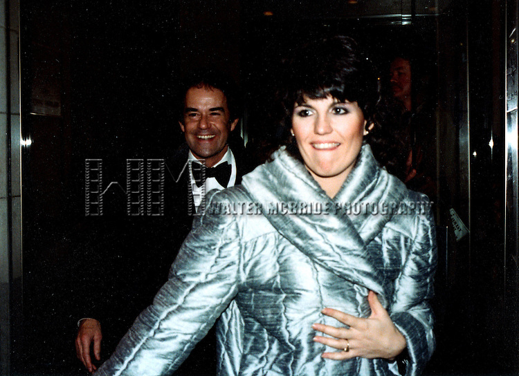 © WALTER McBRIDE / , USA...LUCIE ARNAZ AND .LAURENCE LUCKINBILL  1980.LEAVING SARDI'S RESTAURANT.NEW YORK CITY.CREDIT ALL USES. ©