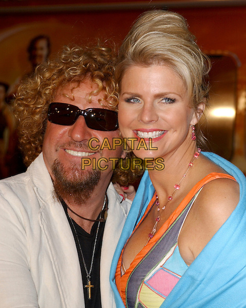 "SAMMY HAGAR & WIFE.Attends Paramount Pictures' Los Angeles Premiere of ""Sahara"" held at The Grauman's Chinese Theatre in Hollywood, Los Angeles, California, USA,.April 4th 2005..portrait headshot sunglasses peace sign gesture funny dark glasses shades.Ref: DVS.www.capitalpictures.com.sales@capitalpictures.com.©Debbie VanStory/Capital Pictures"