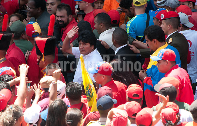 Venezuela: Caracas,06/03/13 .President Evo Morales of Boliva, accompanied by Venezuelan Vice President Nicolas Maduro, greets supporters of Venezuelan President Hugo Chavez died, while watching pass, Lecuna Avenue in Caracas, March 6, 2013, the funeral hearse carrying his remains to Venezuela Military Academy, where he will be rendered honors and veiled in chapel, until Friday March 8, 2013.Carlos Hernandez/Archivolatino