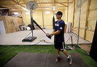 Brandon Nimmo takes a few practice swings inside a batting cage that occupies the family's 2688 sq. ft. barn on Tuesday, June 21, 2011, in Cheyenne, Wyo. The New York Mets recently selected Nimmo at No. 13 overall in the 2011 MLB draft. (Photo by James Brosher)
