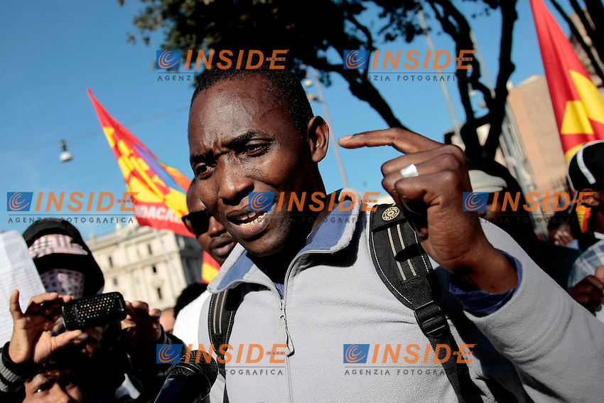 Immigrati <br /> Roma 18-10-2013 Manifestazione dei sindacati di base USB e COBAS in occasione dello sciopero nazionale dei lavoratori.<br /> Strike and demonstration of the Left Trade Unions<br /> Photo Samantha Zucchi Insidefoto