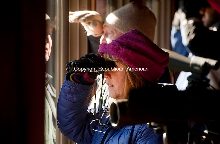 SOUTHBURY, CT--- -122015JS03--Volunteer Peggy Zabawar looks for bald eagles at the Shepaug Dam Bald Eagle Observation Area in Southbury, talks with guests during their visit on Sunday. The observation area is now open for the season from 9 am to 1 pm Wednesday, Saturday and Sunday through March 13th. For more information or to make reservations, go to www.shepaugeagles.info<br /> Jim Shannon Republican-American