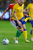 Sweden's Christian Wilhelmsson falls during the UEFA EURO 2012 Group E qualifier Hungary playing against Sweden in Budapest, Hungary on September 02, 2011. ATTILA VOLGYI