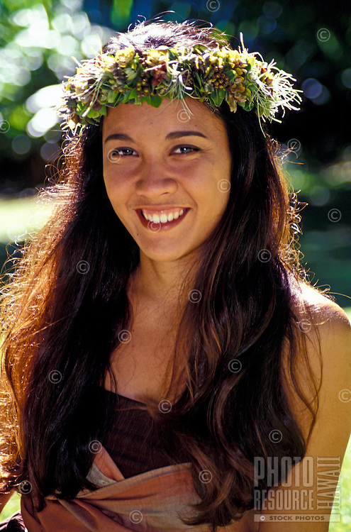 Smiling young island woman wearing a haku lei.