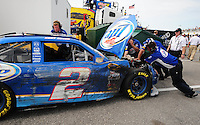 Jul. 3, 2008; Daytona Beach, FL, USA; The damaged car of NASCAR Sprint Cup Series driver Kurt Busch is pushed from the garage after crashing during practice for the Coke Zero 400 at Daytona International Speedway. Mandatory Credit: Mark J. Rebilas-