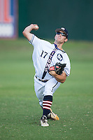 Chris Martin (17) of the High Point-Thomasville HiToms warms up in the outfield prior to the game against the Asheboro Copperheads at Finch Field on June 12, 2015 in Thomasville, North Carolina.  The HiToms defeated the Copperheads 12-3. (Brian Westerholt/Four Seam Images)