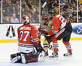 Chris Rawlings (Northeastern - 37), Johnny Gaudreau (BC - 13), Luke Eibler (Northeastern - 20) - The Boston College Eagles defeated the Northeastern University Huskies 7-1 in the opening round of the 2012 Beanpot on Monday, February 6, 2012, at TD Garden in Boston, Massachusetts.