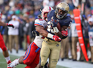 Annapolis, MD - November 11, 2017: Navy Midshipmen running back Josh Brown (28) gets tackled by a Southern Methodist Mustangs defender during the game between SMU and Navy at  Navy-Marine Corps Memorial Stadium in Annapolis, MD.   (Photo by Elliott Brown/Media Images International)