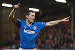 Jon Daly celebrates his goal but Nicky Clark claims it