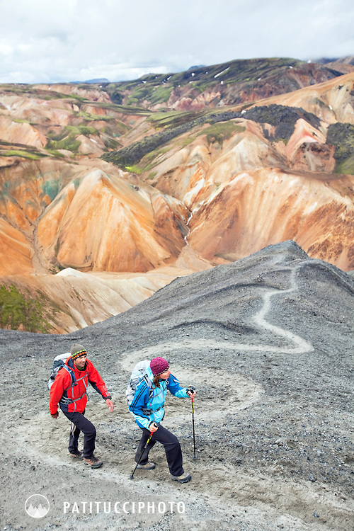 Two trekkers on a switchbacked trail in Landmannalaugar, Icelnd