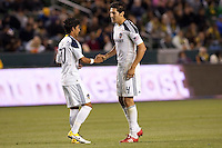 LA Galaxy starting defensive back line (from L-R) A.J. DeLaGarza and Omar Gonzalez kept the Timbers at bay all evening. The LA Galaxy defeated the Portland Timbers 3-0 at Home Depot Center stadium in Carson, California on  April  23, 2011....