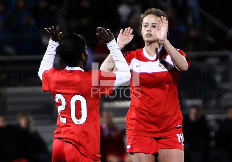 BOYDS, MARYLAND - April 06, 2013:  Jasmyne Spencer (20) and Caroline Miller (10) of The Washington Spirit after Jasmyne Spencer (20) had scored against the University of Virginia women's soccer team in a NWSL (National Women's Soccer League) pre season exhibition game at Maryland Soccerplex in Boyds, Maryland on April 06. Virginia won 6-3.