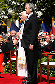 U.S. President George W. Bush and Pope Benedict XVI listen to the Vatican's National Anthem during a South Lawn welcoming ceremony at the White House in Washington, D.C. USA 16 April 2008. During their Oval Office meeting today Pope Benedict XVI is expected  to raise topics such as the Iraq war and immigration.