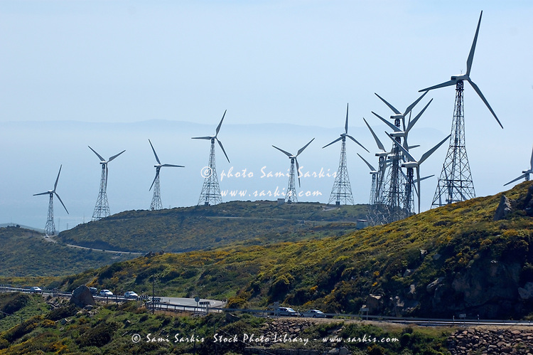 Wind turbines on hills above E5 N340 Highway near Tarifa, Andalusia, Spain.
