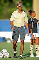 27 August 2011:  FIU Women's Soccer Head Coach Thomas Chestnutt watches as his players warm up prior to the match.  The FIU Golden Panthers defeated the University of Arkon Zips, 1-0, at University Park Stadium in Miami, Florida.