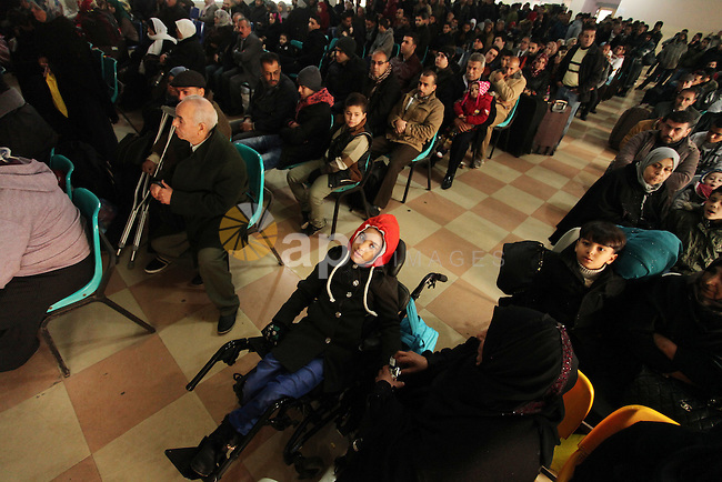 Palestinians wait for travel permits to cross into Egypt through the Rafah border crossing after it was opened by Egyptian authorities for humanitarian cases, in Rafah in the southern Gaza Strip December 17, 2016. Photo by Ashraf Amra