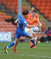 Blackpool's Matthew Virtue under pressure from Peterborough United's Alex Woodyard<br /> <br /> Photographer Kevin Barnes/CameraSport<br /> <br /> The EFL Sky Bet League One - Blackpool v Peterborough United - Saturday 13th April 2019 - Bloomfield Road - Blackpool<br /> <br /> World Copyright &copy; 2019 CameraSport. All rights reserved. 43 Linden Ave. Countesthorpe. Leicester. England. LE8 5PG - Tel: +44 (0) 116 277 4147 - admin@camerasport.com - www.camerasport.com