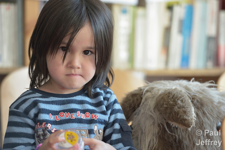 An Afghan girl enjoys playing in a government-run refugee center in Vamosszabadi, Hungary. Hungarian Interchurch Aid, a member of the ACT Alliance, provides child care and other services to residents in the center, who come from Syria, Iraq and other countries and are bound for western Europe.