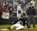 Seattle Mariners Ichiro Suzuki slides into third base after earlier hitting a ball into center field which broke George Sisler's 1920 single season record of 257 in the third inning against the Texas Rangers on Friday, Oct. 1, 2004 at Safeco Field in Seattle. Suzuki got three hits in the game raising his single season total to 259 hits. Jim Bryant Photo. ©2010. ALL RIGHTS RESERVED.