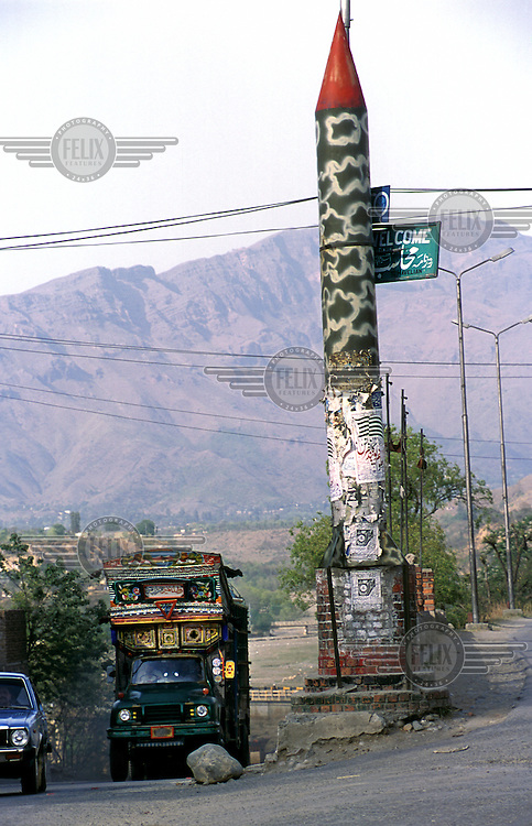 © Piers Benatar/Panos Pictures..North West Frontier Province, Pakistan. 2001...Pakistan is very proud of its status as the only Muslim nuclear power, a pride which manifests itself in sculptures, murals and merchandising paraphernalia depicting its Ghauri and Shaheen missiles.