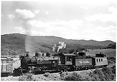 D&amp;RGW #497 K-37 pulling caboose #0517 at Cumbres.<br /> D&amp;RGW  Cumbres, CO  Taken by Payne, Andy M. - 8/21/1954