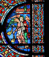 2 thurifers or incense-bearer angels, to the right of the Assumption of the Virgin, from the Glorification of the Virgin stained glass window, in the nave of Chartres Cathedral, Eure-et-Loir, France. This window depicts the end of the Virgin's life on earth, her dormition and assumption, as told in the apocryphal text the Golden Legend of 1260. Chartres cathedral was built 1194-1250 and is a fine example of Gothic architecture. Most of its windows date from 1205-40 although a few earlier 12th century examples are also intact. It was declared a UNESCO World Heritage Site in 1979. Picture by Manuel Cohen
