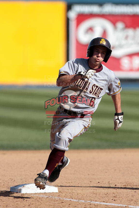 Tucker Esmay #6 of the Arizona State Sun Devils rounds third base during a game against the Long Beach State Dirtbags at Blair Field on March 11, 2012 in Long Beach,California. Arizona State defeated Long Beach State 6-1.(Larry Goren/Four Seam Images)