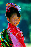 7 year old girl wearing kimono (Seven-five-three festival), Kitano-Tenmangu Shrine, Kyoto, Japan
