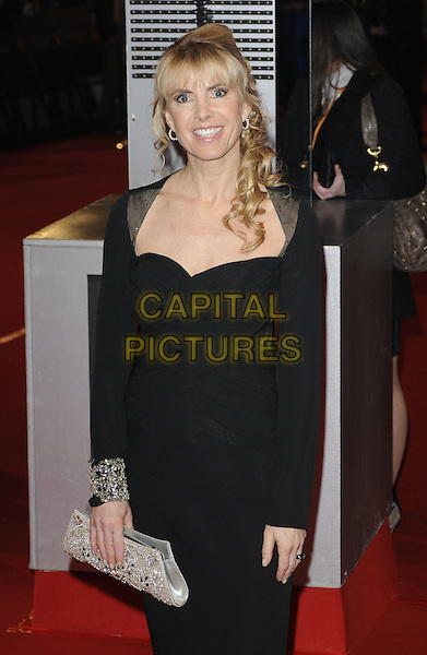 GUEST .Arrivals at the Orange British Academy Film Awards 2010 at the Royal Opera House, Covent Garden, London, England, UK, .21st February 2010.BAFTA BAFTAs half length black dress  Silver clutch bag.CAP/CAN.©Can Nguyen/Capital Pictures
