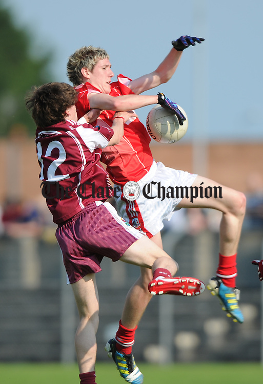 Padraig Mc Namara of Lissycasey in action against James Woods of Eire Og during their U-16 Division 1 county final at Cusack Park. Photograph by John Kelly.
