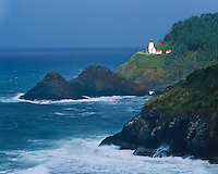 Light breaking through a storm at Heceta Head Lighthouse on the Pacific Ocean; Devil's Elbow State Park, OR