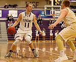 SIOUX FALLS, SD - NOVEMBER 25: Zach Wessels #11 from the University of Sioux Falls brings the ball up court against Nick Dufault #12 from Southwest Minnesota State University during their game Saturday night at the Stewart Center in Sioux Falls. (Photo by Dave Eggen/Inertia)